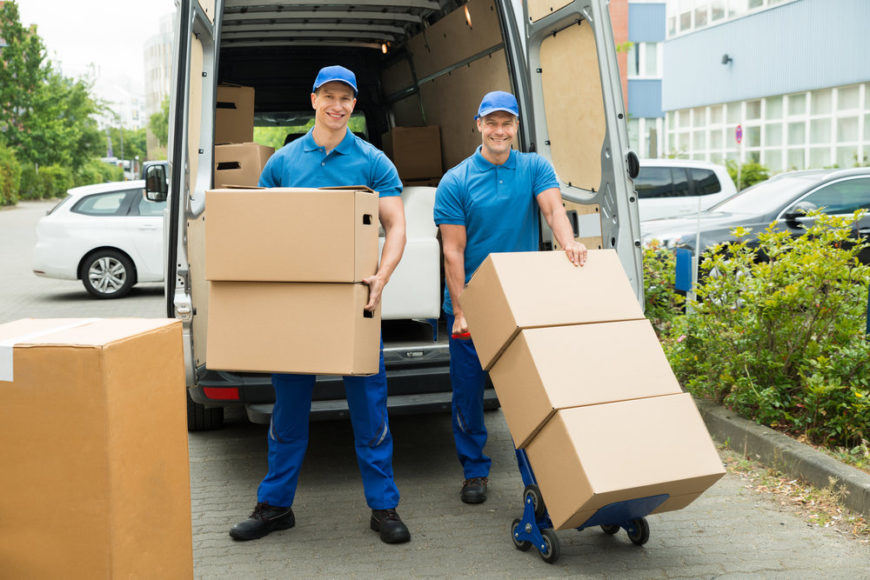 Two Workers Loading Cardboard Boxes In Truck | SEO & Web Design Gainesville FL